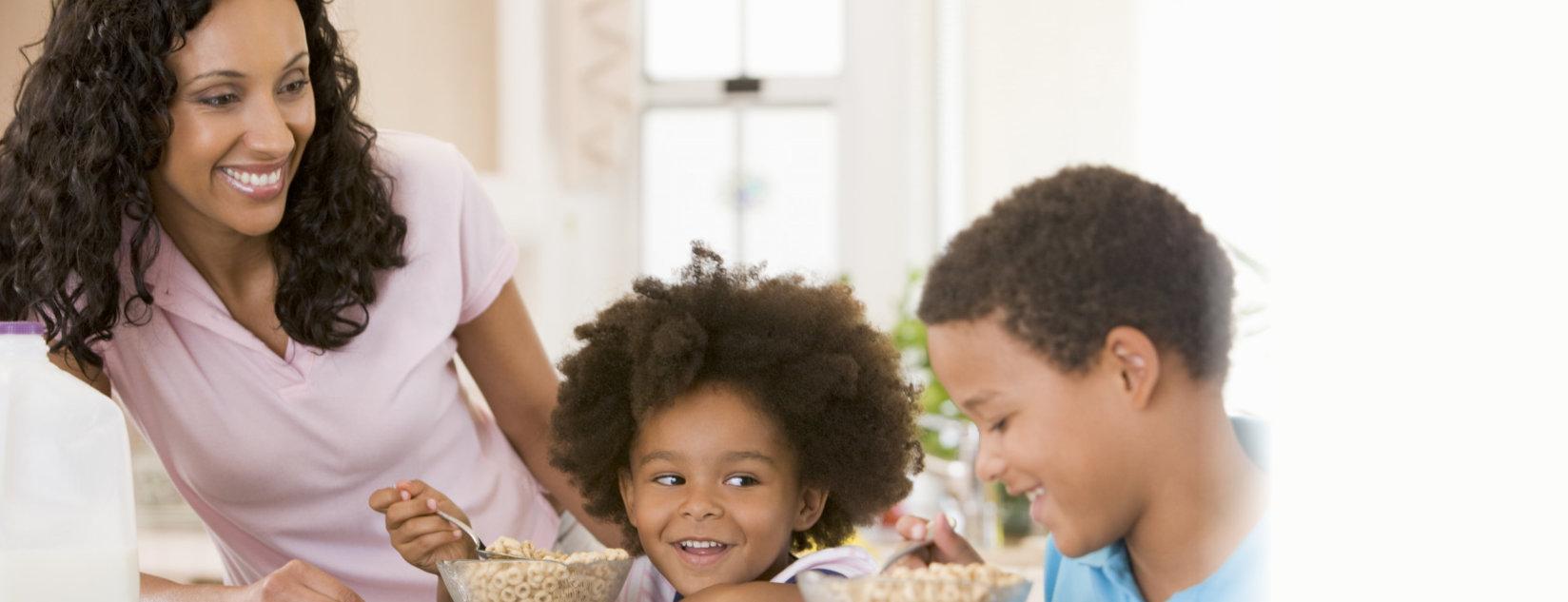 Children Eating Breakfast. Indoors, mealtime.